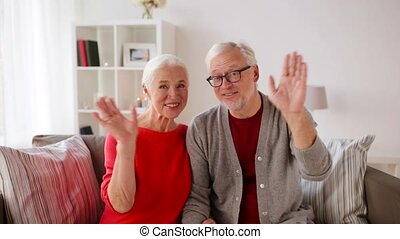 senior couple recording video greeting - old age, blogging...
