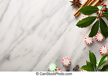 Peppermint candy and spices on marble background - Christmas...