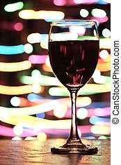 Glass of red wine - Wine glasses with blured motion lights...