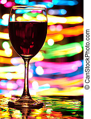 Wine and defocused lights - Wine glasses with blured motion...
