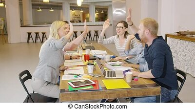 Colleagues clapping hands - Group of colleagues in casual...