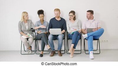 Colleagues offering ideas - Group of colleagues in casual...