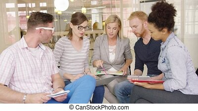 People working on new plans - Group of young people in...