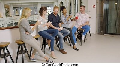 People clinking with cups of coffee - Group of people in...