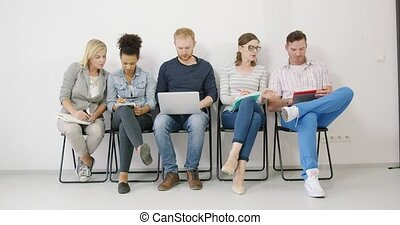 Colleagues making notes and sharing ideas - Group of...