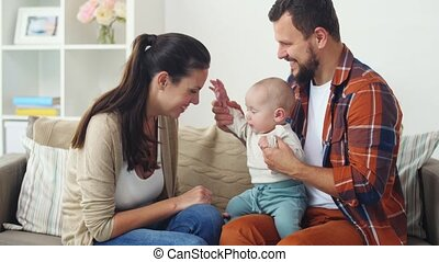 happy family with baby at home - family, parenthood and...