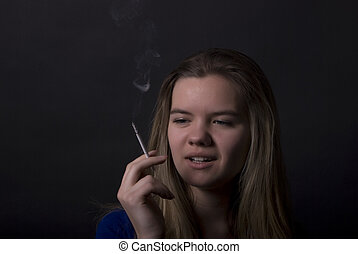 smoking girl - young female smoking addict