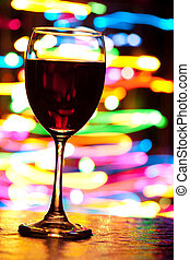 Holiday celebration - Wine glasses with blured motion lights...