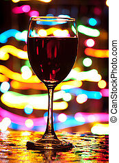 Holiday celebration - Wine glass with blured motion lights...