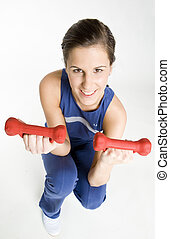 woman exercising with dumb bells