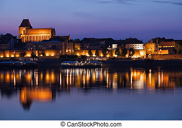 Night City Skyline of Torun from Vistula River - City of...