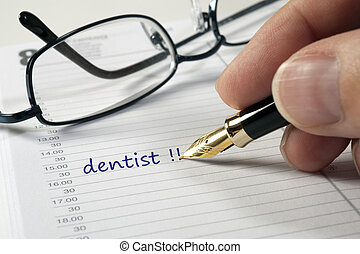 dentist doctor date written by hand in calendar