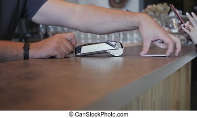 Making payment with credit card and pos terminal, printed...