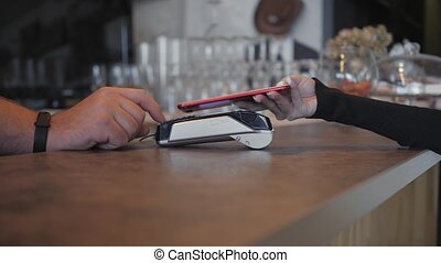 Concept NFC contactless payment. Making payment with mobile...