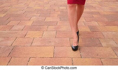 female legs in high heels close-up. 4k, slow motion, red...