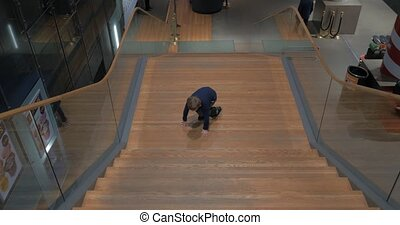 Child having fun on the staircase in the hall - HELSINKI,...