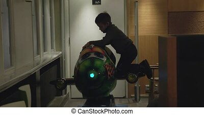 Child riding amusement plane in cafe - HELSINKI, FINLAND -...