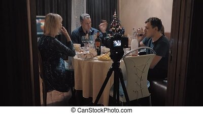 Making footage of family Christmas dinner - Camera on tripod...