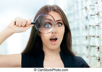 Funny Woman with Magnifying Glass Ready For Eye Exam -...