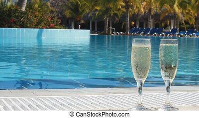 Champagne - Two Champagne Glasses By The Side Of A Swimming...