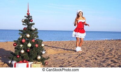 girl in costume on the new resort on the beach with gifts 1...