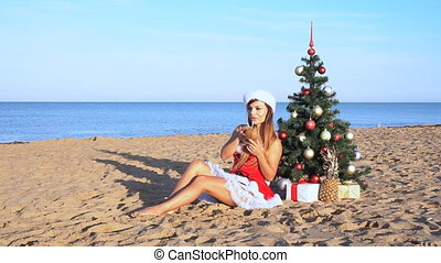 girl on beach resort in Christmas clothes for the new year 1...