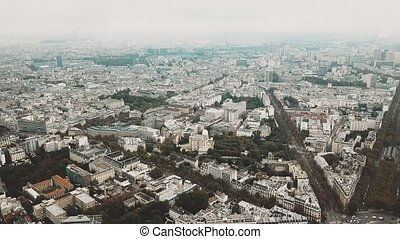 High altitude aerial panoramic shot of Paris cityscape as...