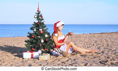 girl on beach resort in Christmas clothes for the new year -...