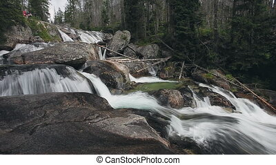 Mountain river with cascade waterfall in forest - Powerful...