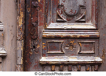 Detail part of decorative old wooden door with ornament in...