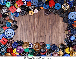 Wooden background with old fashion assorted buttons with...