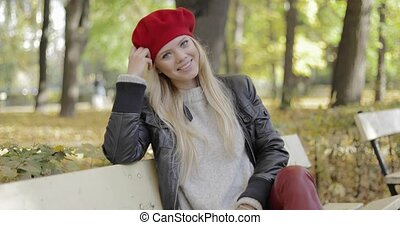 Woman in beret leaning head on hand - Attractive young woman...