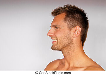 Profile of smiling young man. - Profile of smiling attractiv...