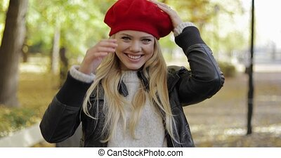 Attractive woman in red beret in park - Attractive young...