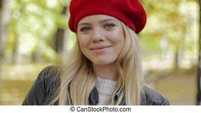 Cheerful woman in red beret - Beautiful cheerful woman in...