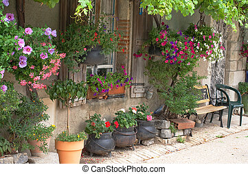 French cottage - A french cottage with lots of hanging...