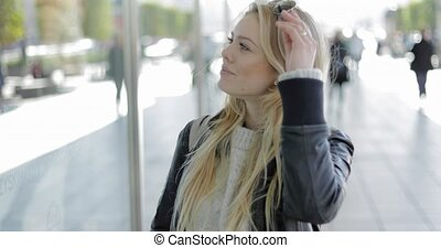 Woman looking at shop-window - Attractive young woman...
