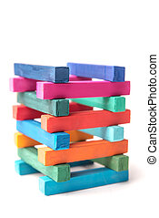 Close up of hight colorful chalks tower, isolated over white...