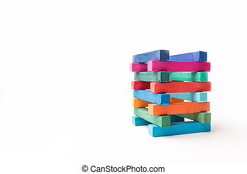 Hight colorful chalks tower, isolated on white background
