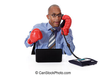 Attractive young African American businessman, boxing gloves...