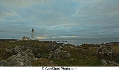 lighthouse at nord sea - Scotland, time-lapse at dusk, wide...
