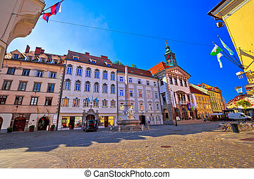 Ljubljana old town cobbled street and city hall view,...