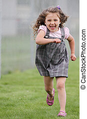 Girl running towards camera in skirt - Girl running towards...