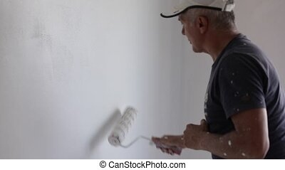 Paint roller slow motion - slow motion of paint roller in...