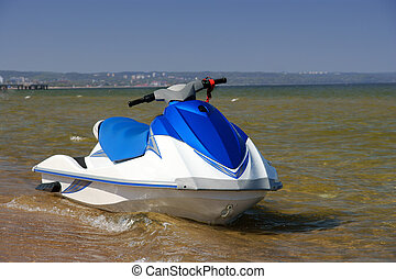 Jetski on the beach, - blue white Jetski on the beach,