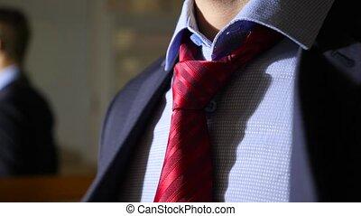 unrecognizable businessman takes off his suit. 4k, slow...