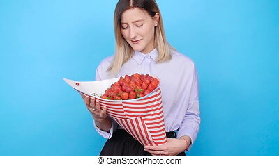 Young woman with a bouquet of strawberries - A cute young...