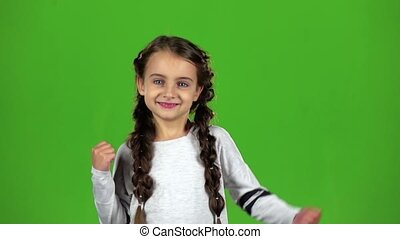 Child rejoices in victory. Green screen. Slow motion - Child...