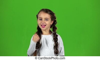 Baby rejoices in victory. Green screen. Slow motion - Child...