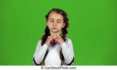 Baby crosses his fingers in his arms. Green screen. Slow...